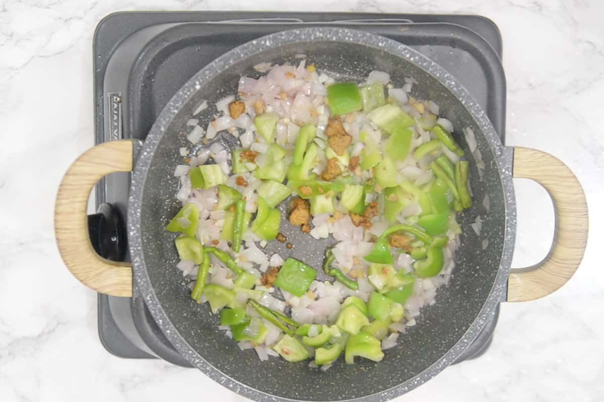 Stock cube crumbled in the wok.