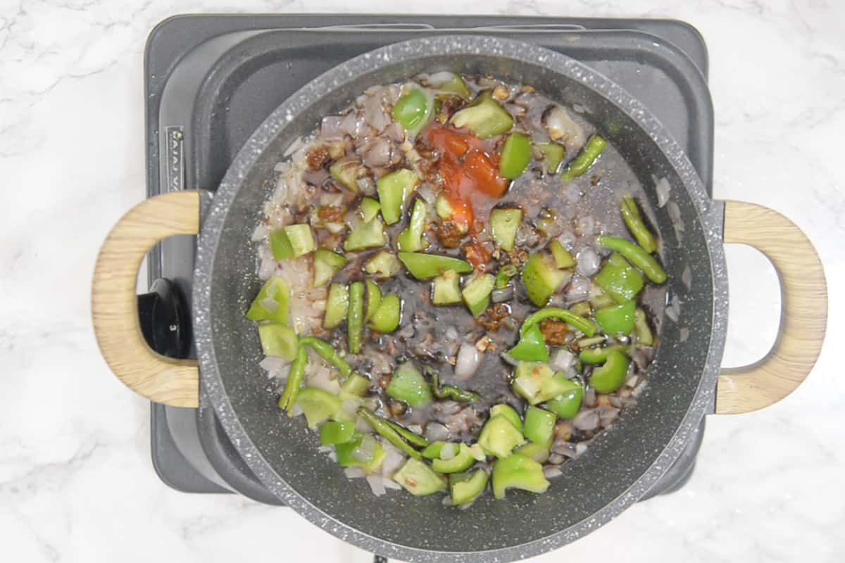 sauces and water added in the wok.