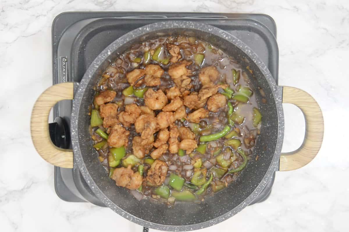 Fried prawns added in the wok.