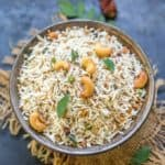 This South Indian Coconut Rice Recipe is a mildly spiced and light rice dish cooked with coconut flakes.