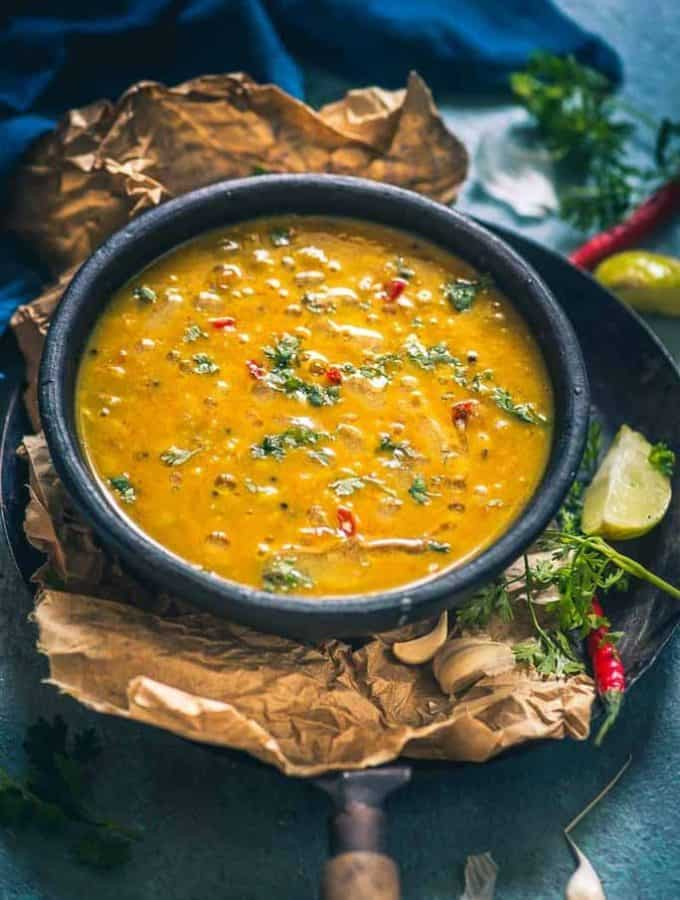 Served with a dollop on ghee on the steamed rice or with piping hot phulkas, Gujarati Dal ends up making that perfect lighthearted meal you are craving for!