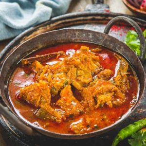 Rajasthani Laal Maas is a traditional Rajasthani dish which is fiery hot and deep red in color. It is best enjoyed with Indian breads or rice.