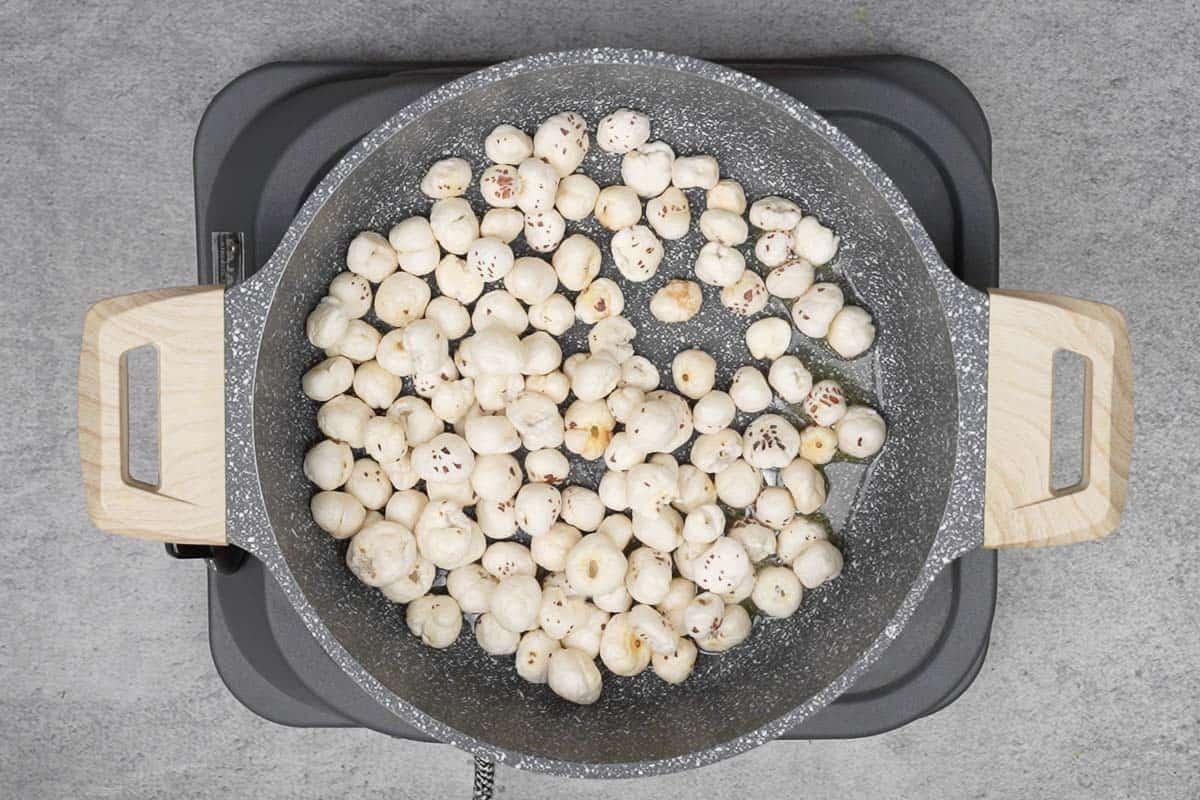 Makhana roasting in the pan.