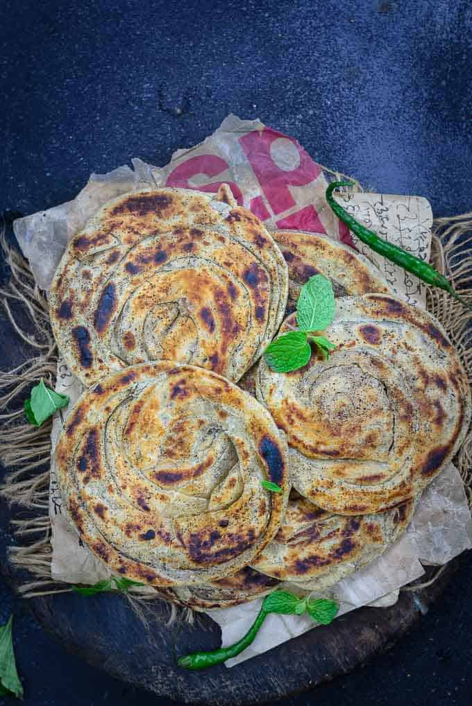 Pudina paratha stacked on a plate.