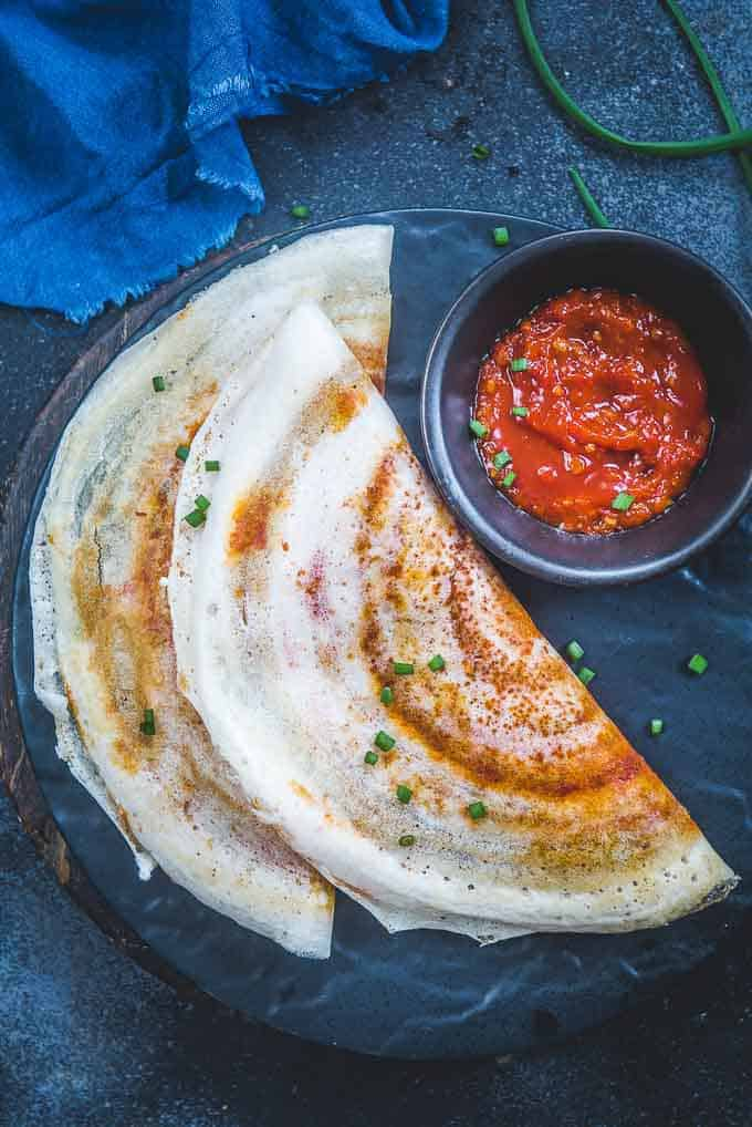schezwan dosa served on a plate.