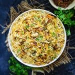 Hyderabadi Vegetable Dum Biryani is a delicious medley of succulent vegetables, spices, ghee, saffron and flavourful basmati rice which no one can resist.