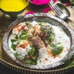 Dahi Vada or Dahi Bhalle are fried lentil dumplings, topped with curd, variety of chutney and spices. It's a famous Indian Chaat recipes and a very popular street food.
