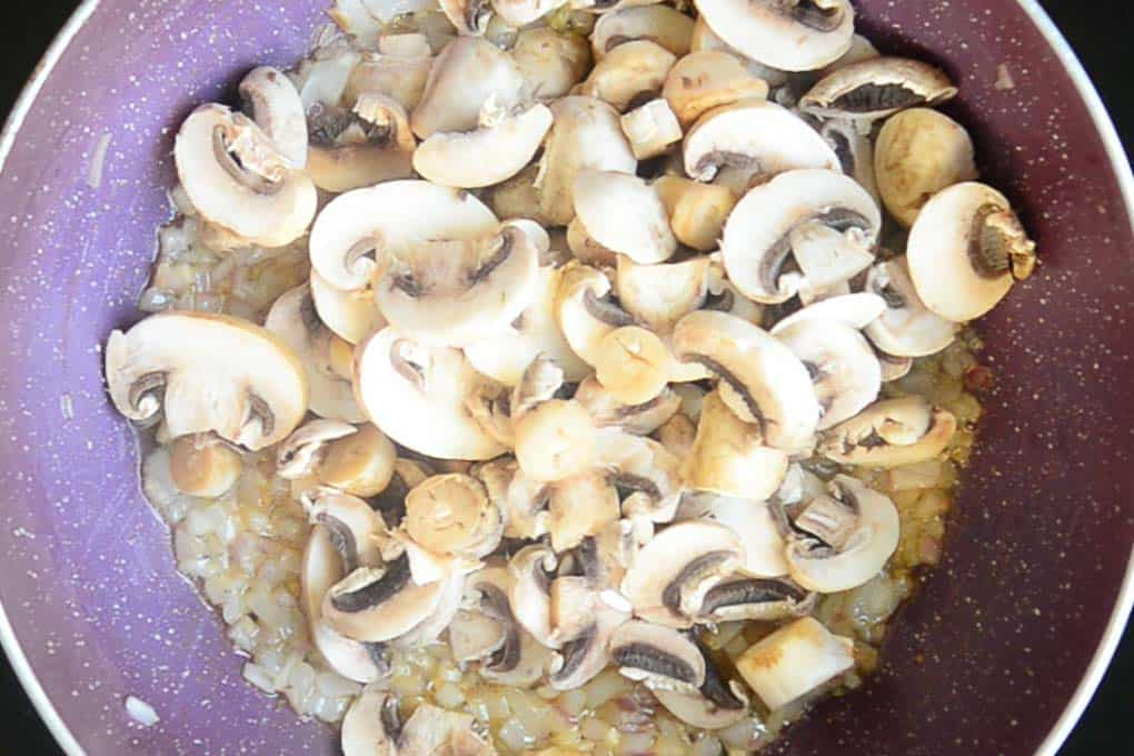 Mushroom slices added in the pan