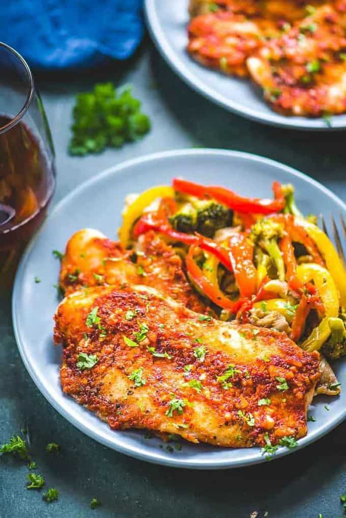 Spicy Baked Basa in a plate served along with sautéed vegetables.