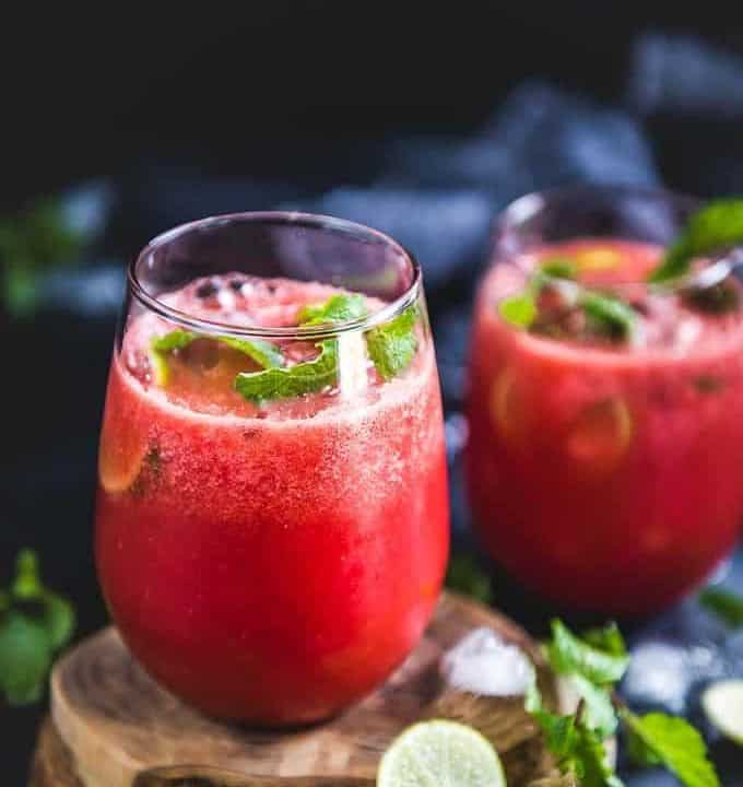 Side view of Watermelon ginger juice served in glasses