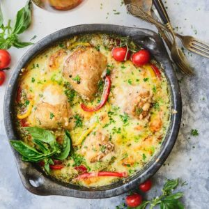 A gluten-free, scrumptious fusion of basil pesto, chicken, parmesan cheese and more, this Creamy Baked Pesto Chicken Thighs Recipe gets baked within 30 minutes and you could spend the rest licking your plates clean, ha!