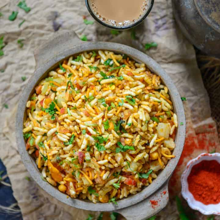 Spicy & Tangy Jhal Muri is a popular street food of Kolkata made using puffed rice. The pungent taste of raw mustard oil makes it quite unique. Here is how to make it.