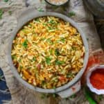Jhal Muri is a popular street food of Kolkata made using puffed rice. The pungent taste of raw mustard oil makes it quite unique. Here is how to make Jhal Muri Recipe.