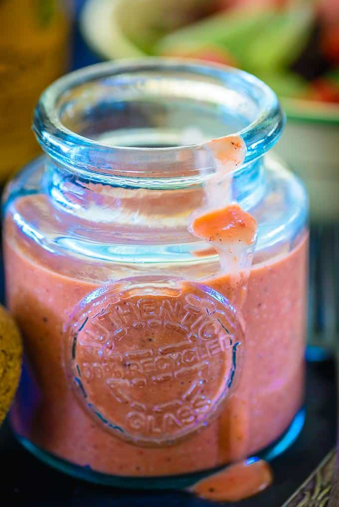 Close up shot of easy balsamic strawberry vinaigrette recipe served in a jar