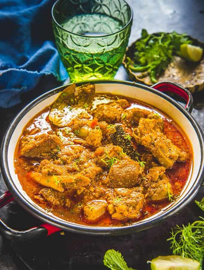 Mutton curry served in a bowl.