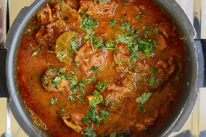 Mutton curry garnished with coriander.