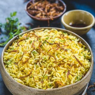 Persian Saffron Rice served in a bowl.