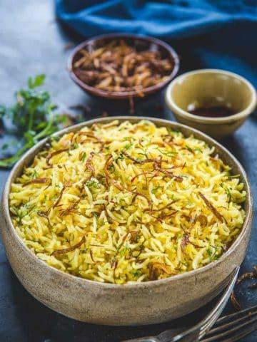 Persian Saffron Rice served in a bowl.