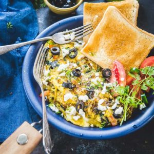 A classic Greek breakfast loaded with spinach and feta cheese, Greek Omelette suits perfectly for breakfast!