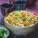 Got a day old rice? Want to revamp it? Make this quick and easy, not too mention uber delicious stir-fried Egg Fried Rice in a skillet or wok in minutes!
