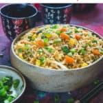 Got a day old rice? Want to revamp it? Make this quick and easy, not too mention uber delicious stir-fried Egg Fried Rice in a skillet or wok in minutes! It more than just a simple Chinese side dish and gets made in a jiffy as well! #Asian #Recipe #Egg #Rice #maincourse #Chinese