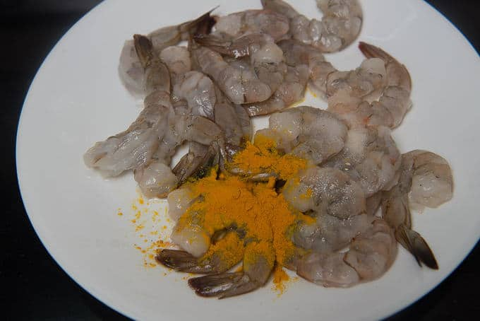 Prawns marinated with salt, turmeric powder and lemon juice.