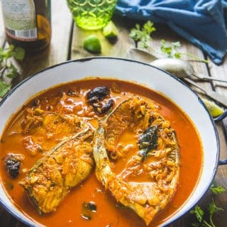 Kerala Fish Curry served in a serving bowl.