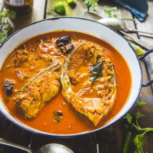 Kerala Fish Curry is a traditional Malabari dish and is a tad spicy curry.