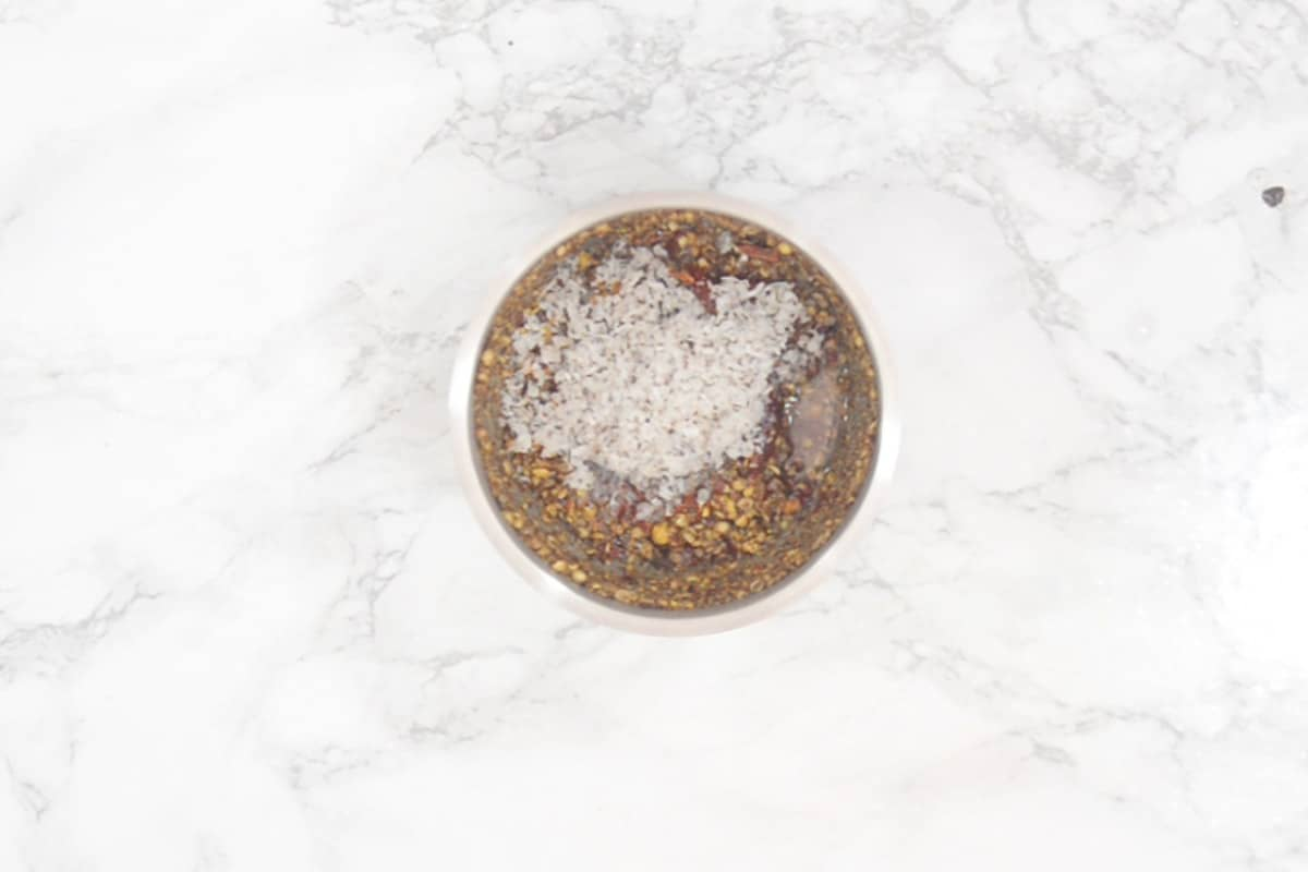 Roasted mixture added in a grinder along with coconut and water.
