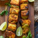 Achari Paneer tikka is a delicious starter made with paneer (Indian Cottage Cheese) marinated in an achari (Pickle spices) marinade. The soft and juicy morsels of paneer coated with spicy and tangy masala is a delight to eat. Here is how to make it.