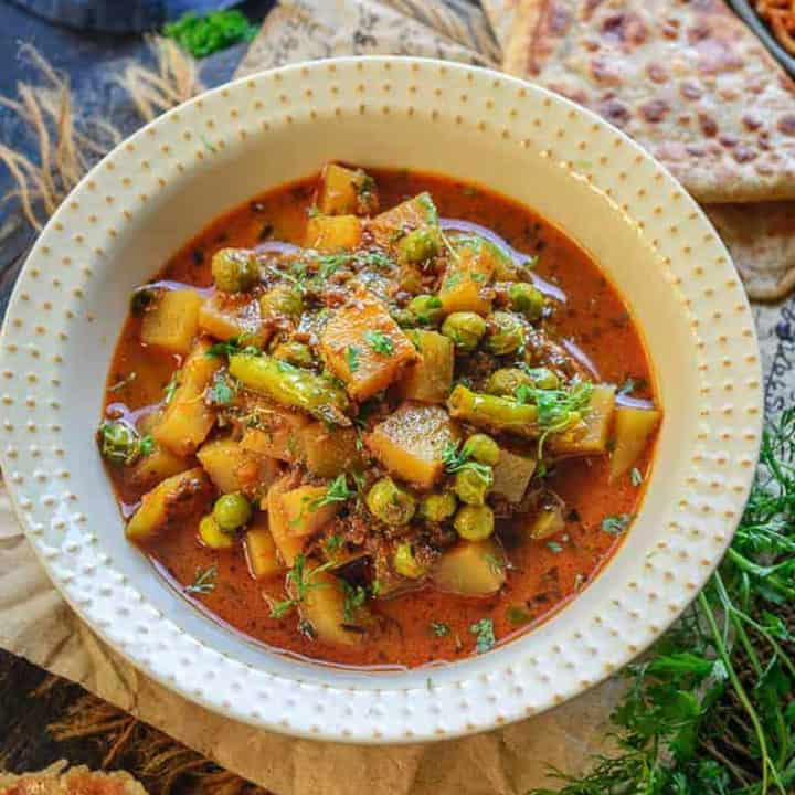 Aloo Matar Curry is a simple, delicious Indian main course dish that vouches for a wholesome, healthy meal for your family. Made using potato cubes, fresh peas, and a spicy masala, this vegan and gluten-free dish is perfect to serve with any Indian bread. Here is how to make it.