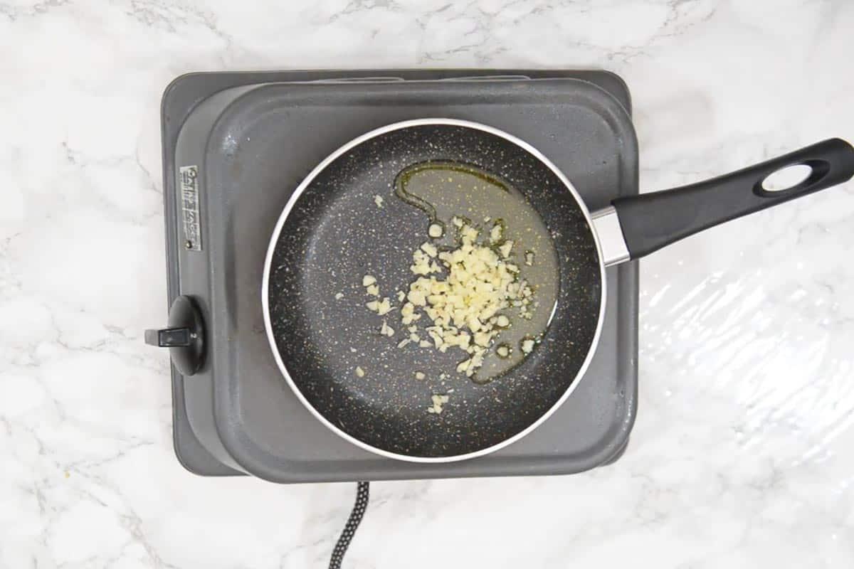Garlic added in olive oil.
