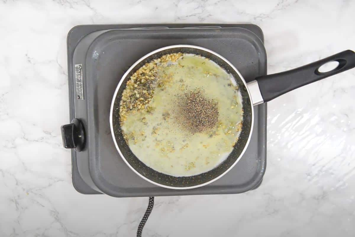 Egg whites, salt and pepper added in the pan.