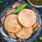 Matar Kachori are flaky crisp, deep fried pastries filled with a spicy pea filling and are best enjoyed with Khatti Meethi Imli Ki Chutney for tea