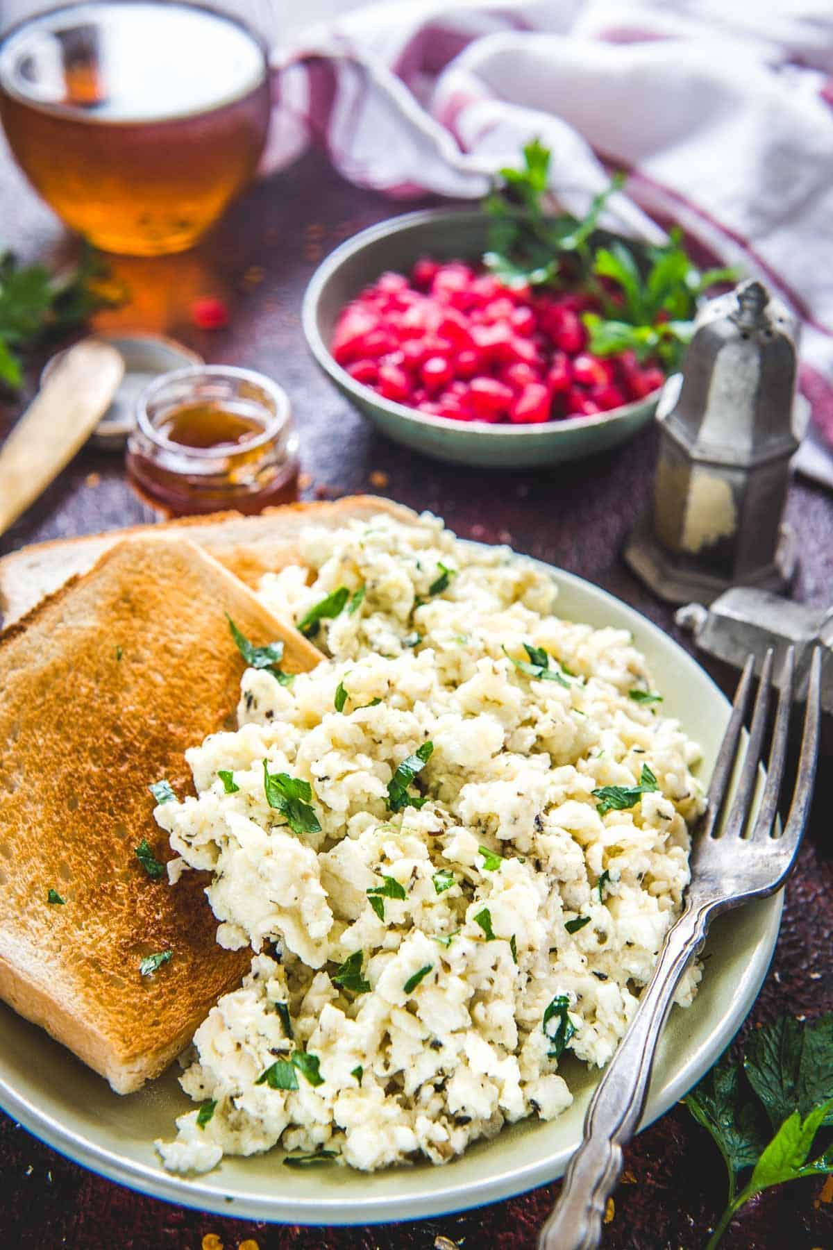 Scrambled Egg Whites served on a plate with toast.