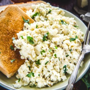 Egg White Scramble is a healthy, fluffy, and delicious option for breakfast. Serve it with some toast and fruits and milk on the side. Here is how to make the best fluffy scrambled egg white recipe at home!