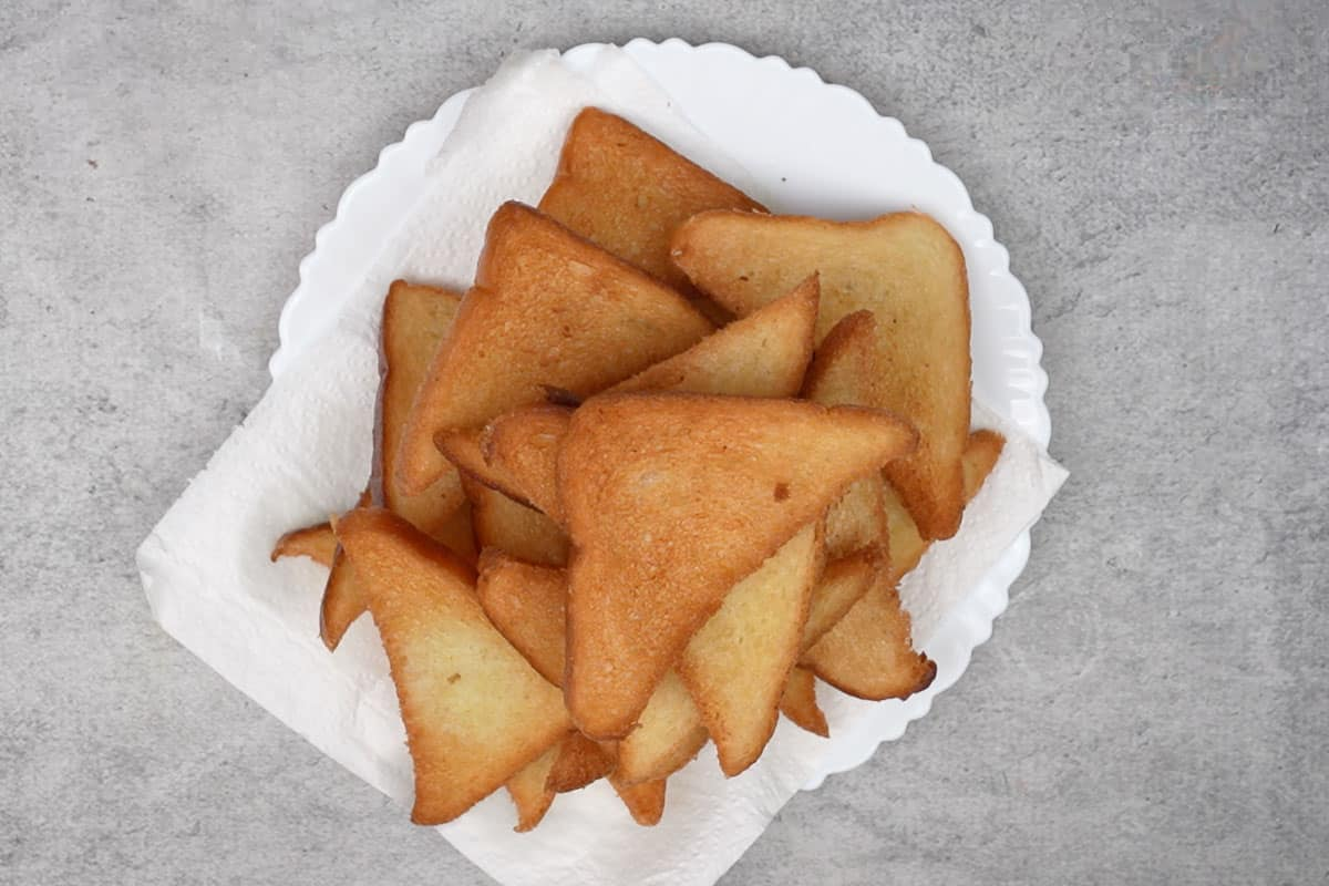 Fried bread slices on a plate.