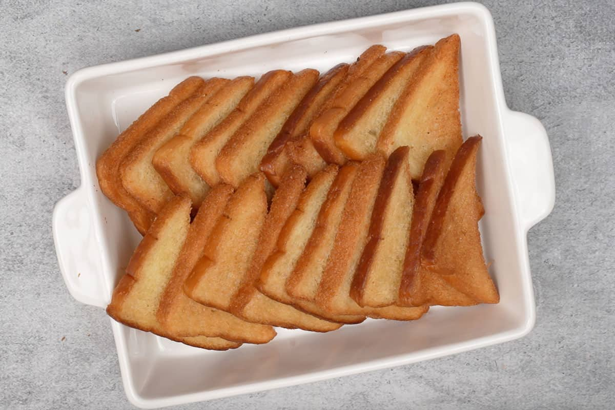 Bread slices arranged on a tray.