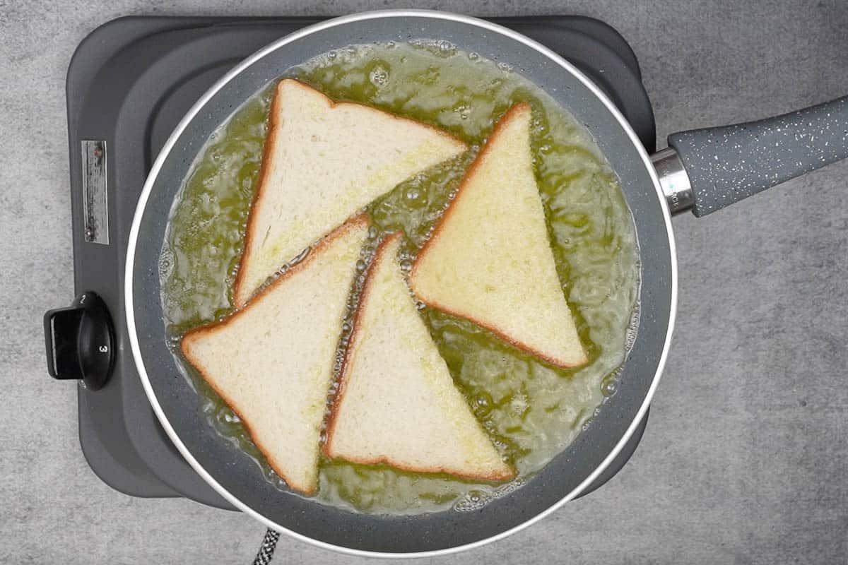 Bread slices frying in ghee.