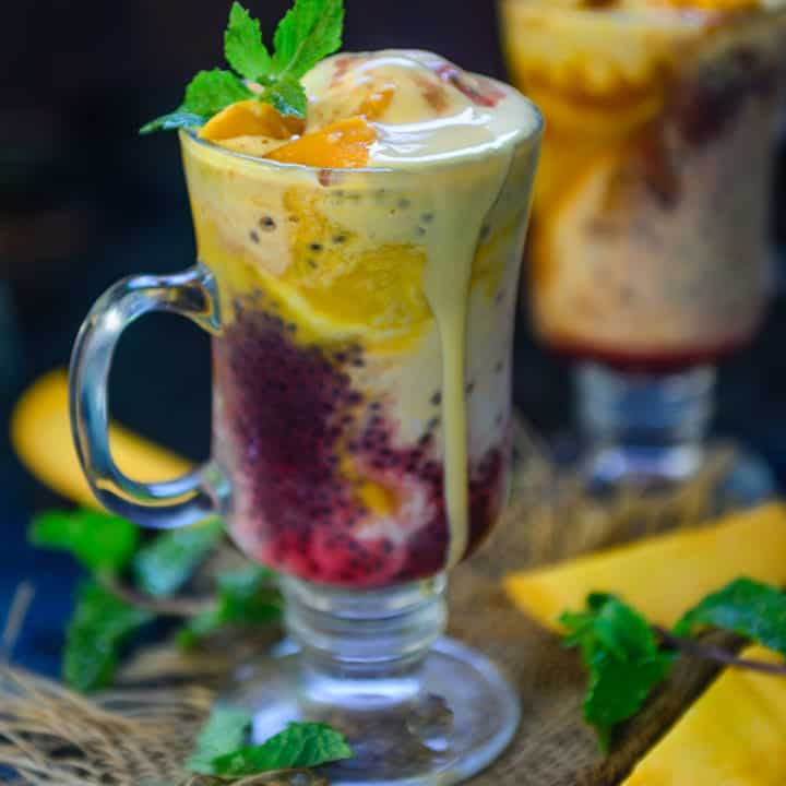 This super yummy Mango Falooda is an Indian beverage or dessert with layers of falooda sev, milk, basil seeds and fresh mango pieces and mango puree layered in a tall glass. It is a delight to eat and one of the best mango recipes.