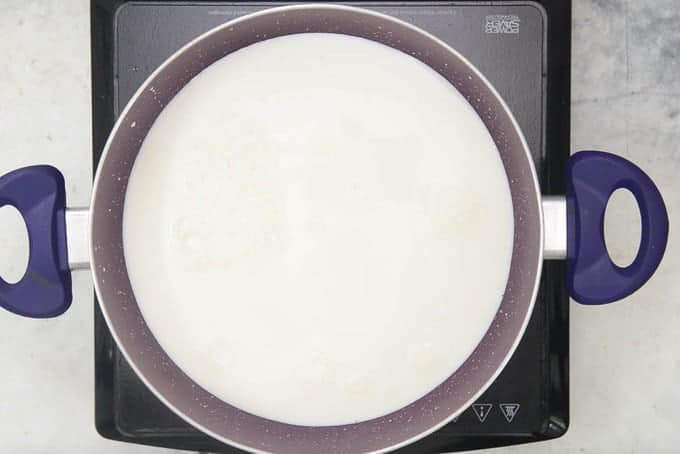 Milk heating in a pan.