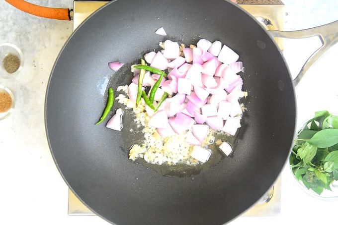Onion and green chilli added in the pan.