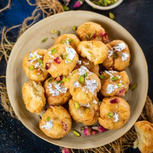 Balushahi (badusha) is a crispy and flaky Indian sweet made using all-purpose flour, ghee, and yogurt. It is popularly made during festivals, weddings, and special occasions. Make it using my tried and tested recipe at home!