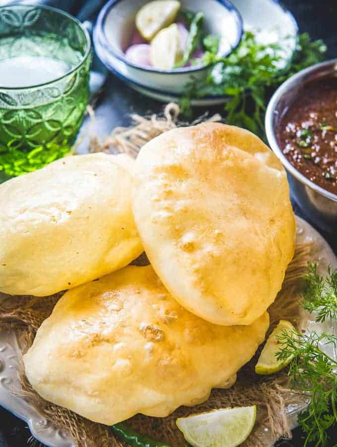 Make sure to knead the dough to a very soft consistency. That is the tick to restaurant style fluffy bhatura.