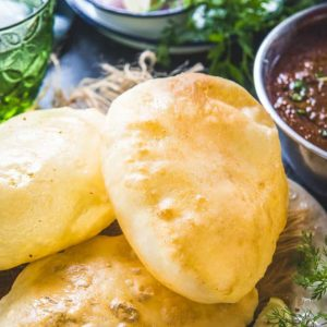 Bhatura is a fluffy and deep fried Indian bread that is served with golden brown chickpea curry. It is made from flour maida (purpose flour), yogurt.