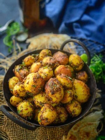 Jeera Aloo served in a bowl.