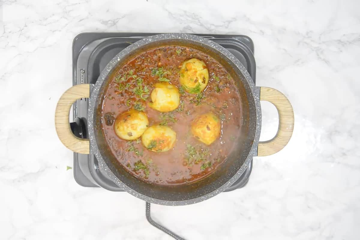 Ready egg curry garnished with coriander.