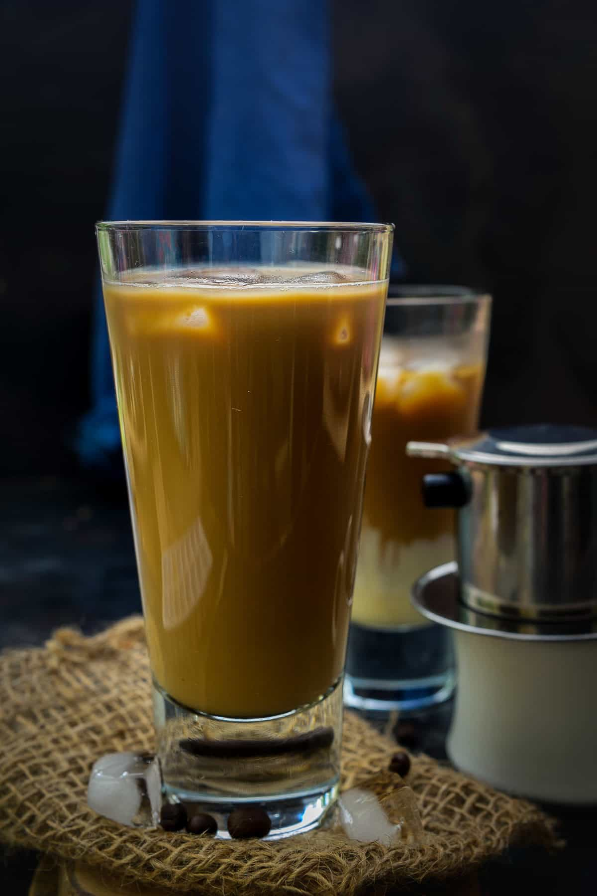 Vietnamese coffee served in a glass.