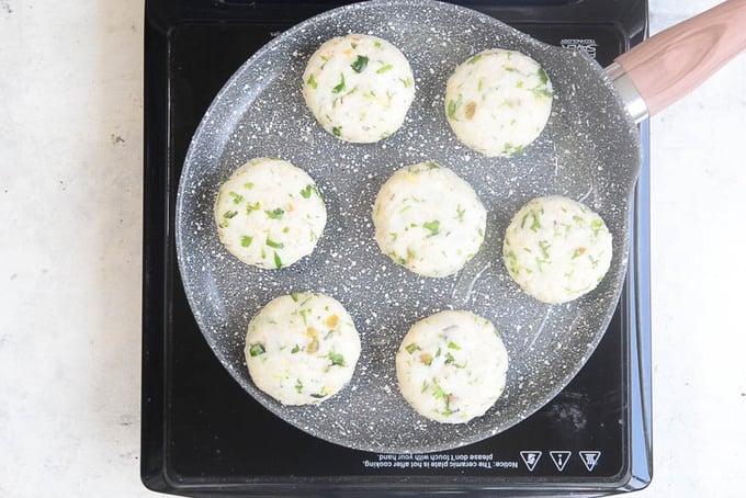 Tikki frying in a pan.