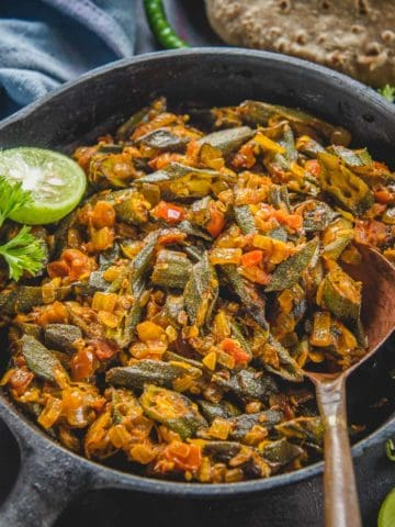 Bhindi Masala is a very popular North Indian dish made using Okra, Onion, tomatoes, and spices. This semi-dry curry is super easy to make, made using basic ingredients, and comes together in under 30 minutes. It's vegan and gluten-free too.